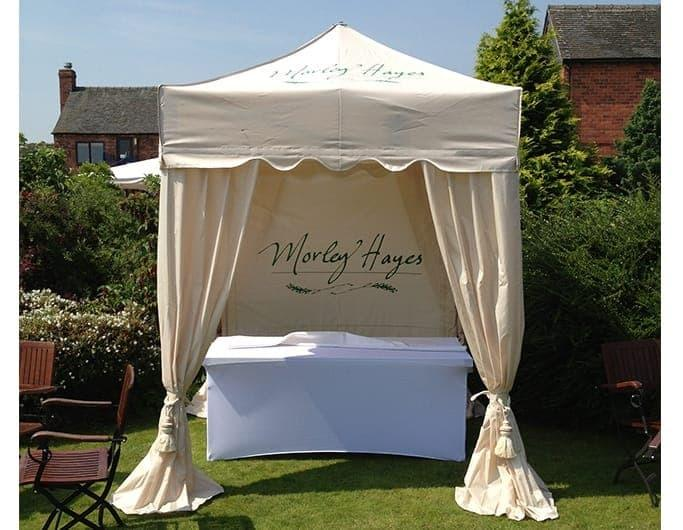 <p>Tent – Royal – Morley Hayes Hotel</p> <p>2m x 2m</p> <p>Morley Hayes is a luxurious Hotel and Golf Club and are registered to conduct Weddings. They have chosen the Royal Tent with draped corner Curtains. They have produced their Tents in cream with their logo in green to create a romantic feel in an outside setting.</p>