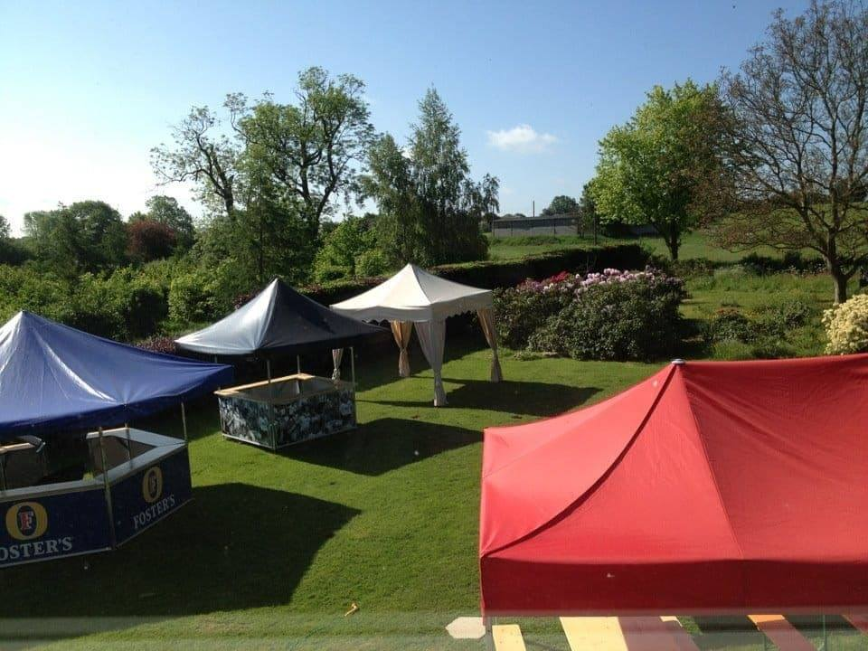 <p>Events, Mobile & Stadia Bars – Tents & Marquees – Pavilions & Folding Tents</p> <p>Displaying an outdoor showroom with a Classic and Royal Folding Tent plus Square & Octagonal Pavilion. Some have branding, whilst others show plain colours.</p>