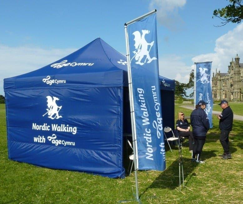 <p>Accessories – Ground Flags – Age Cymru</p> <p>4m x 4m</p> <p>The charity, Age Cymru had branded Flags produced for around the entrance to their 3 x 3 tent. It added to their event display.</p>