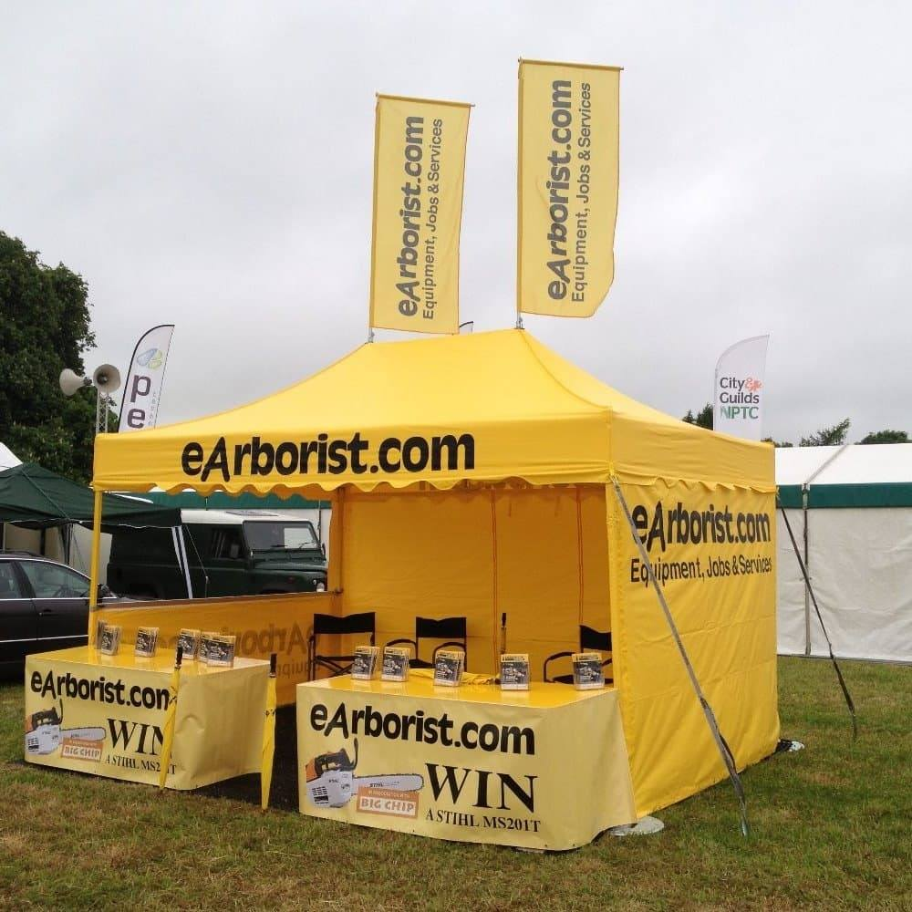 <p>Tent – Classic With Roof Flags – EArborist</p> <p>4.5m x 3m</p> <p>eArborist have chosen the tent in their corporate colours and branded their logo across the roof valance, plus have printed their side walls inside and out. They also have 2 x flags for the roof fully branded.</p>