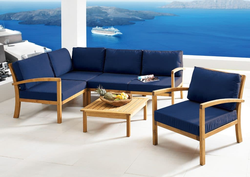 Leisure Collection Patio Set – Table, Corner Settee, Chair & Armchairs in a hotel balcony lounge setting