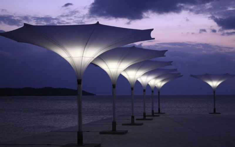 <p>Parasols – Tulip – Stylish Unique Umbrella Shade</p> <p></p> <p>Premium, stylish, trumpet style lightweight, and beautiful centre pole commercial & residential parasol offering the ideal shade solution providing comfort and protection from the environmental conditions be it blazing hot sunshine or pouring rain.</p> <p></p> <p>Suitable for commercial settings, but equally at home in residential settings too – lightweight size enabling customers to experience a continental atmosphere</p> <p></p> <p>Made for shade, but also design, aesthetics and impression an interesting alternative to classic conventional Parasols</p>