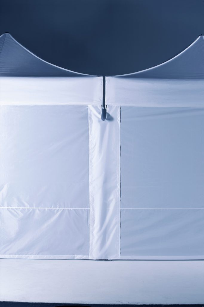 Folding Tent Accessories – Central Connector – a strip of polyester affixed between 2 tents hiding the tent structure to keep wet weather out of the tent