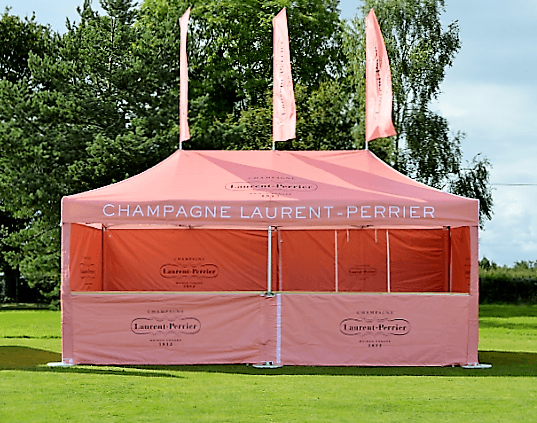 Laurent Perrier pink branded 6m x 3m Folding Tent Bar with full back and side-walls with half height front walls with counters and roof flags.