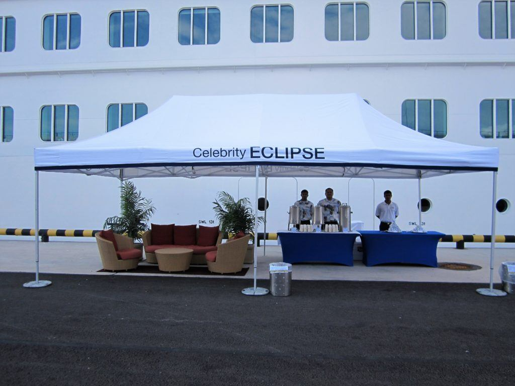 Celebrity Eclipse branded Classic Folding Tent with white branded roof and weights to stable the tent