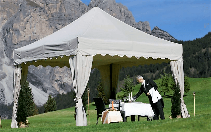 Royal Folding Tent – Ecru in colour with scalloped roof and elegant corner curtains in rural wedding setting