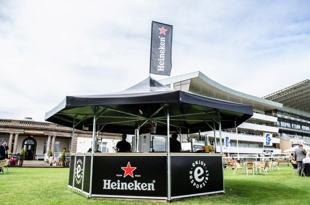 8-sided outdoor event bar full branded for Heineken in black with branded roof flag