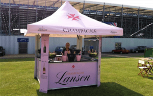 4-sided pavilion kiosk fully branded with Lanson Champagne on both the roof and base panels