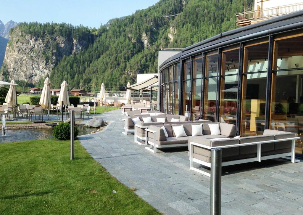 Leisure Collection Veranda Set – Rimini Table and sofas outside a lakeside restaurant setting