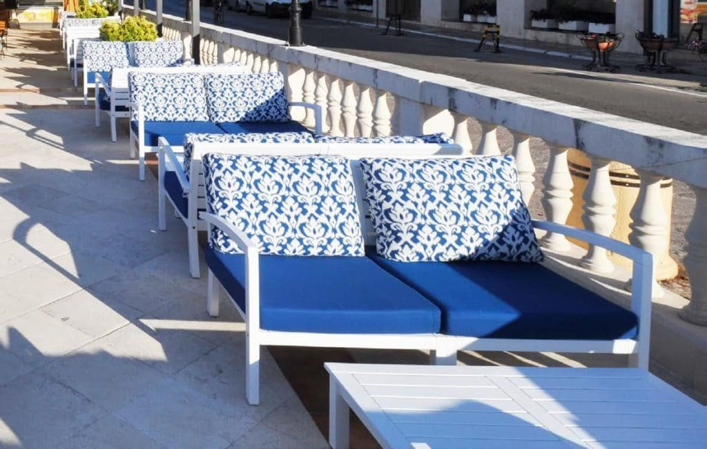 Leisure Collection Patio Set – Tuscany Tables and Chairs in a hotel terrace setting