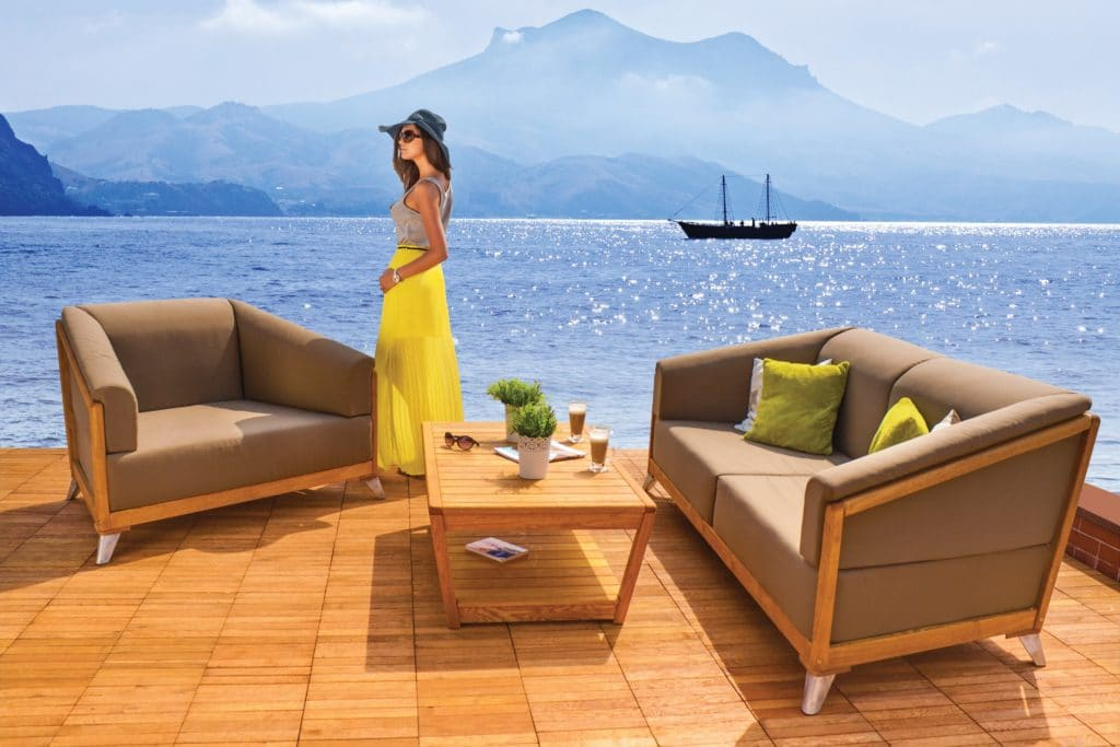 Leisure Collection Venezia Sofa and Armchair Set with Table in a seafront setting