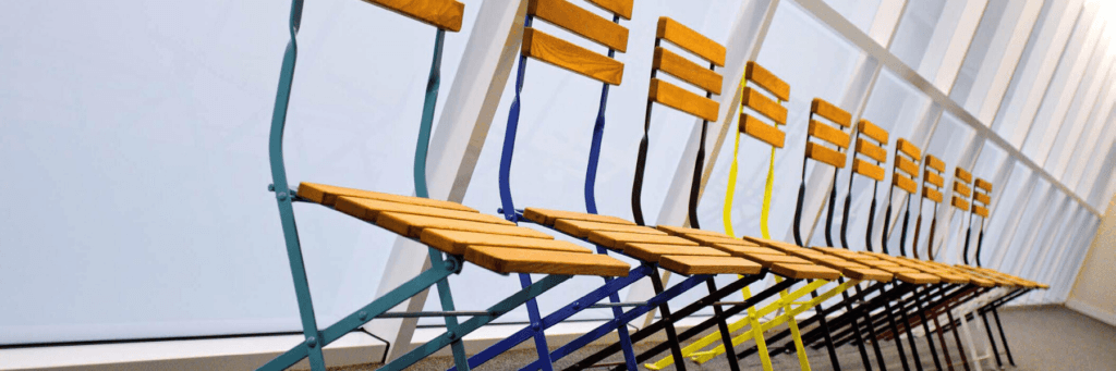 Funzione Furniture row of chairs with different coloured frames
