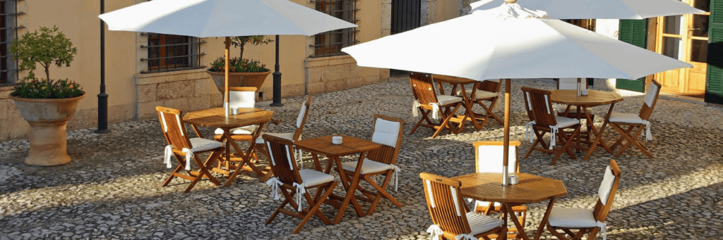 Folding Chairs and Tables in a hotel restaurant terrace setting