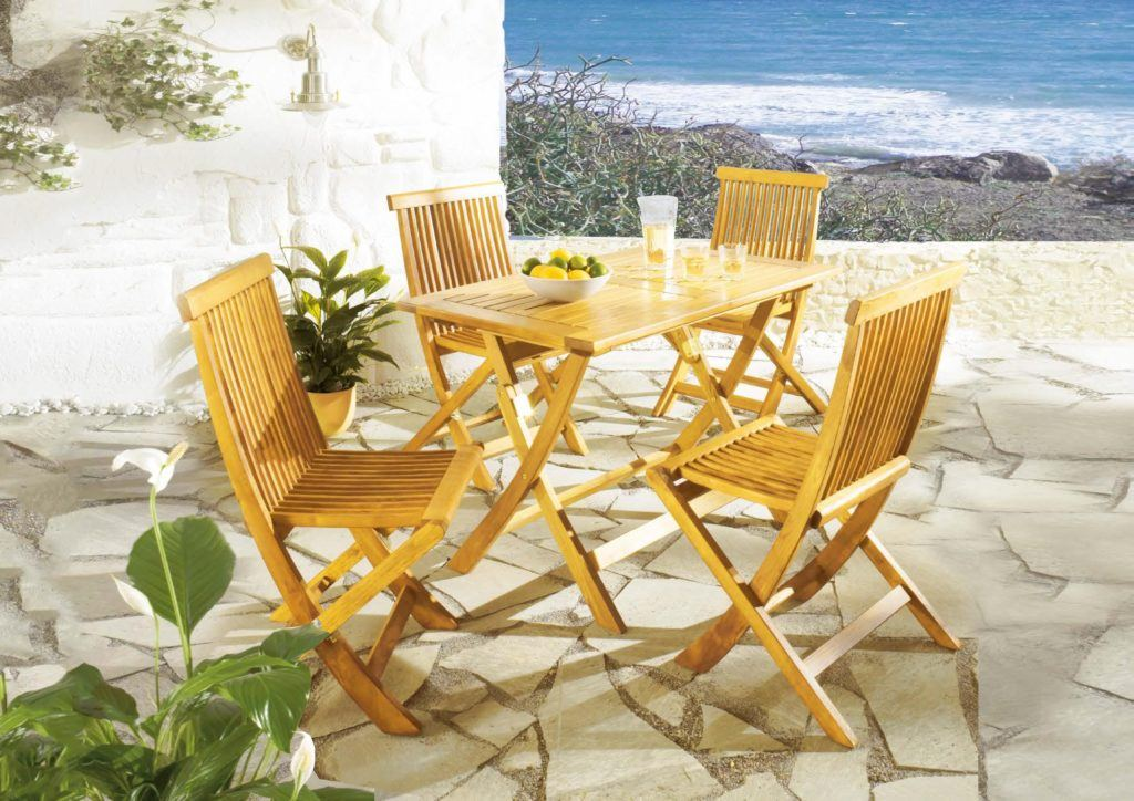 Al fresco seafront hospitality terrace with tables and armchairs