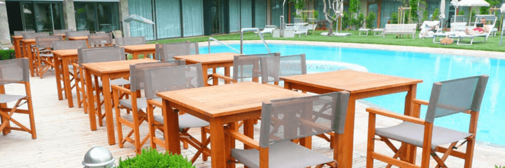 Direttore Foldable Chairs and Tables in a hotel pool terrace setting