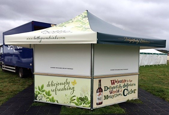 <p>Event, Mobile &amp; Stadia Bars &#8211; Tents &amp; Marquees – Hexagonal Pavilion Festival Bar</p> <p>&nbsp;</p> <p>Demonstrating printing possibilities with dual brand printing – Bottle Green &amp; Merrydown Cider on both roof and base panels.</p> <p>&nbsp;</p> <p>Also includes Night Closure Shelters</p>