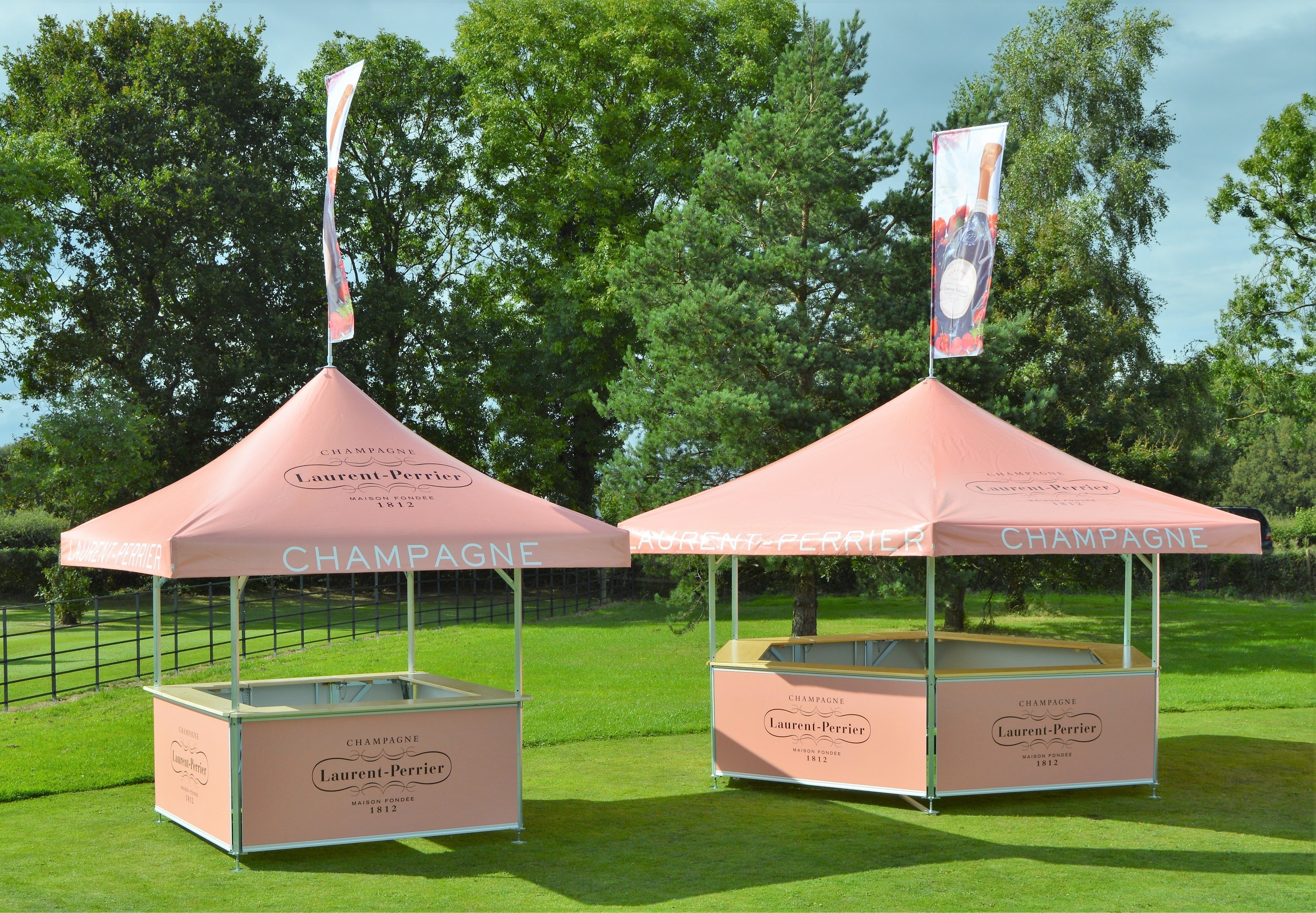 <p>Event, Mobile & Stadia Bars – Tents & Marquees – Hexagonal & Square Pavilions.</p> <p> </p> <p>Laurent Perrier Outdoor Promotional Stand Premium Champagne Event Bar ideally suited for Racecourse or other high-profile sporting events and venues eg cricket ground.</p> <p> </p> <p>Branding opportunities of the roof and base panels are available.  Both include Roof Flags</p>