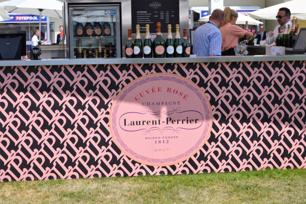 Close up of Laurent Perrier branding on a outdoor champagne bar at Royal Ascot