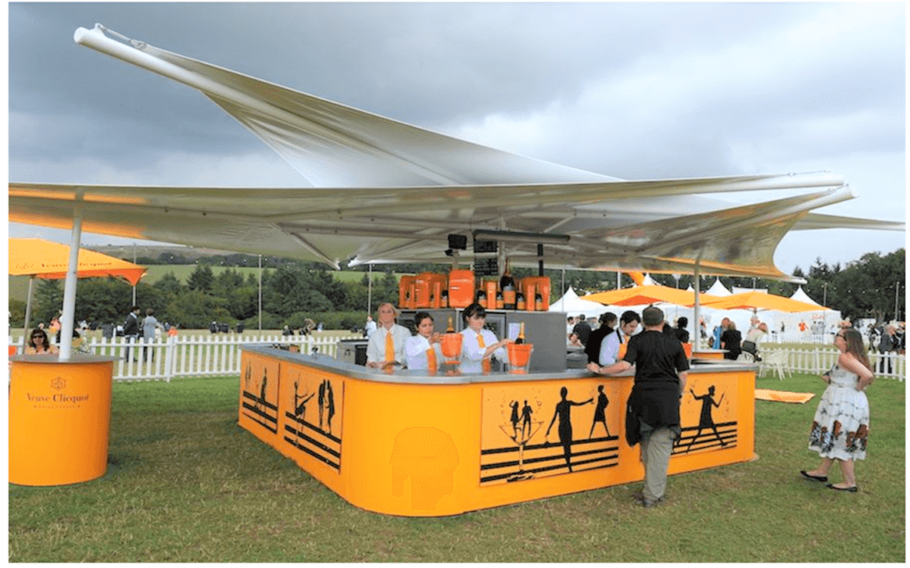 Sail & Canopy premium champagne bar situated on a lawn enclosure at Goodwood Revival