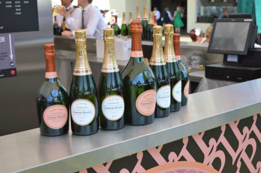Stainless-Steel Champagne Bar counter showing some branding underneath with bottles of premium champagne brands