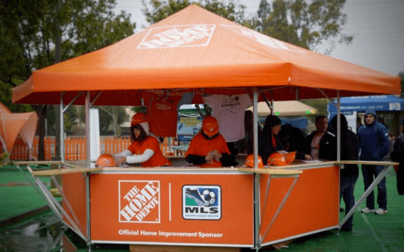 <p>Event, Mobile & Stadia Bars – Tents & Marquees – Pavilions – Hexagonal Promotional Kiosk – Home Depot</p> <p> </p> <p>Includes counter extensions</p> <p> </p> <p>Ideally suited as a promotional retail stand at a show or exhibition</p> <p> </p> <p>Roof and Base panels can be branded according to corporate colours.</p>