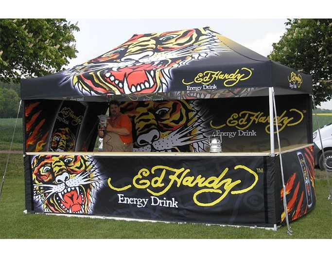 <p>Tents & Marquees – Folding Tents – Classic</p> <p>Ed Hardy fully digitally printed branded gazebo – 4.5m x 3m Classic Folding Tent including half height sidewalls & counters</p>