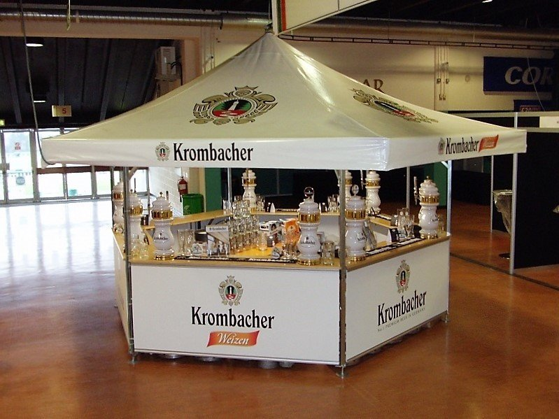 <p>Event, Mobile & Stadia Bars – Tents & Marquees – Hexagonal Pavilion</p> <p> </p> <p>Branded with Krombacher graphics both on the roof and base panels – suited as an outdoor event bar or an indoor event bar</p> <p> </p> <p>With the branded pumps and use of lighting and heating inside this makes this event bar look very classy and stylish</p>