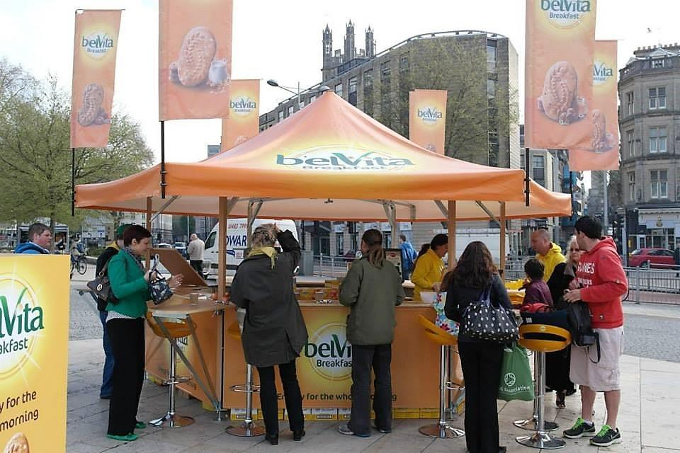 <p>Event, Mobile & Stadia Bars – Tents & Marquees – Hexagonal Pavilion.</p> <p> </p> <p>Outdoor Street Food Bar branded with Belvita corporate identity serving samples, snacks etc for Roadshow.</p> <p> </p> <p>Includes bespoke branded promotional flags and fittings as well as counter extensions.</p>