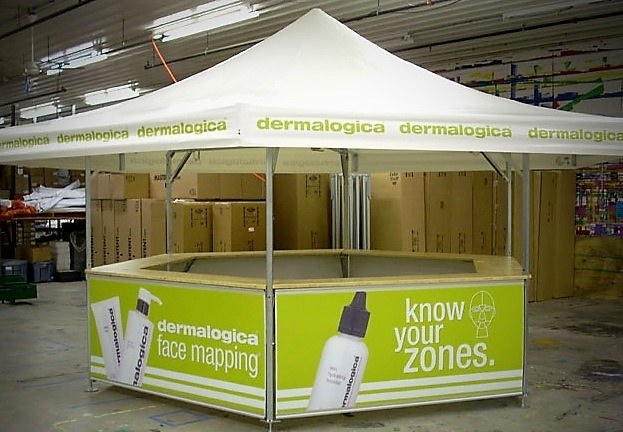 <p>Event, Mobile &amp; Stadia Bars &#8211; Tents &amp; Marquees &#8211; Hexagonal Pavilion &#8211; Dermalogica Promotional Stand</p> <p>&nbsp;</p> <p>Sampling Stand for Dermalogica &#8211; fully branded roof and base panels</p>