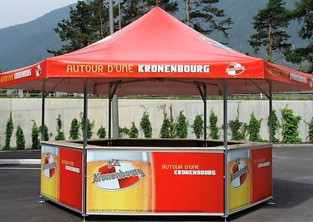 <p>Event, Mobile & Stadia Bars – Tents & Marquees – Hexagonal Pavilion</p> <p> </p> <p>Outdoor Beer Bar with fully branded roof and base panels for Kronenbourg Beer</p>