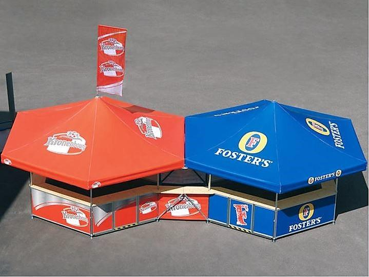 <p>Event, Mobile & Stadia Bars – Tents & Marquees – Pavilion – Hexagonal – Foster's & Kronenbourg.</p> <p> </p> <p>Demonstrating joining kit functionality with 2 x hexagonal pavilions branded as Fosters and Kronenbourg outdoor football stadia bars.</p> <p> </p> <p>Also includes roof flag with full Kronenbourg branding</p>