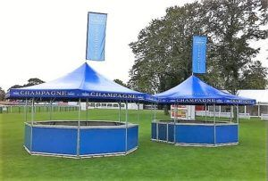 2 x 8-sided bars branded for premium champagne with roof flags as accessories