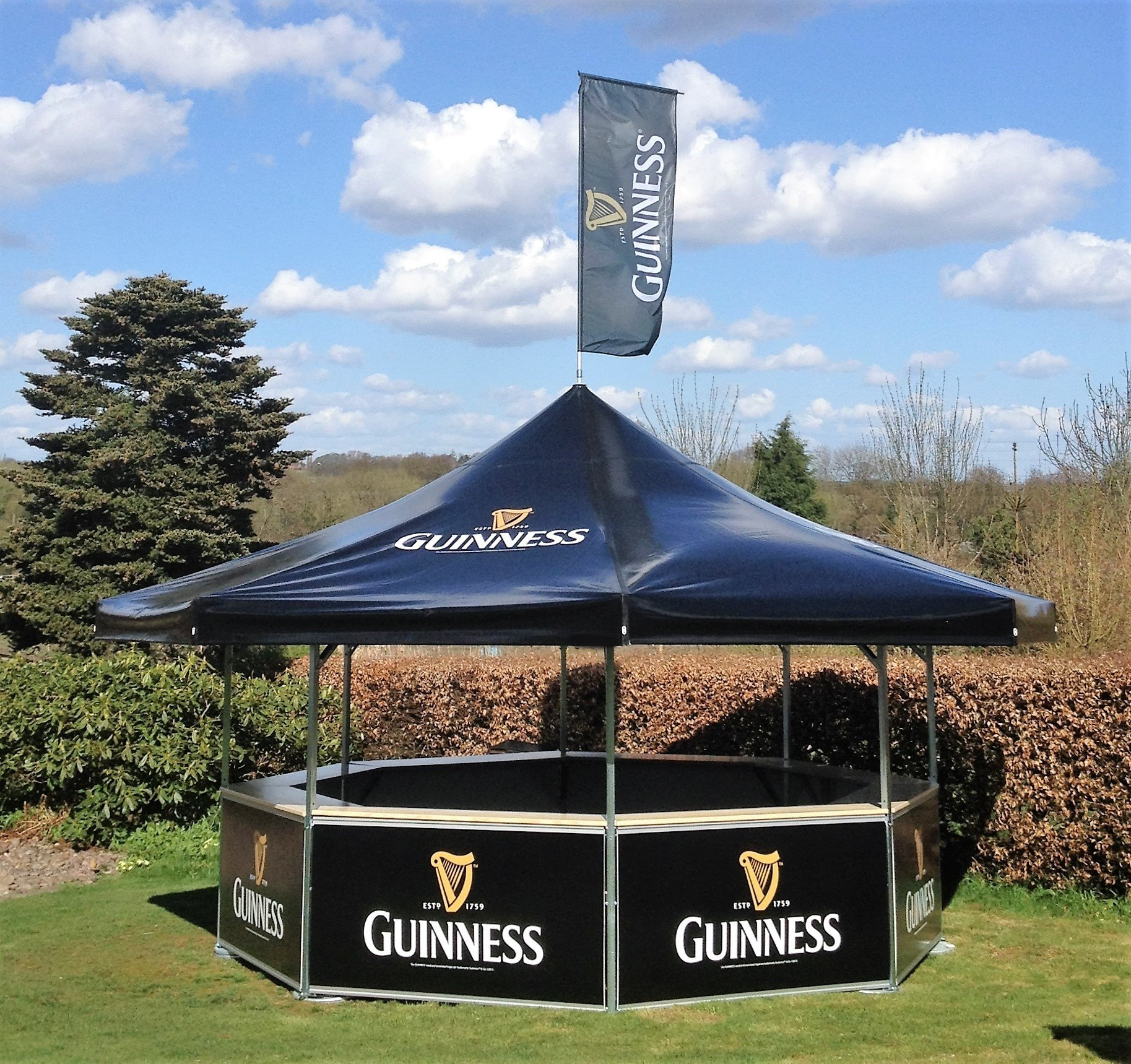 <p>Event, Mobile & Stadia Bars – Tents & Marquees – Octagonal Pavilion – Outdoor Guinness Event Bar.</p> <p> </p> <p>Fully branded Guinness Bar used at racecourse events etc.  Can be used at football stadiums hosting concerts and other events.</p> <p> </p> <p>Includes fully branded roof flag accessory enabling better visibility of location of bar at event or venue</p>