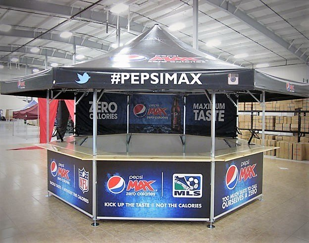 <p>Event, Mobile &amp; Stadia Bars &#8211; Tents &amp; Marquees &#8211; Octagonal Pavilion &#8211; PepsiMax Promotional Stand.</p> <p>&nbsp;</p> <p>Fully branded roof and base panels with PepsiMax corporate identity to be used as a promotional stand or sampling stand.</p> <p>&nbsp;</p>