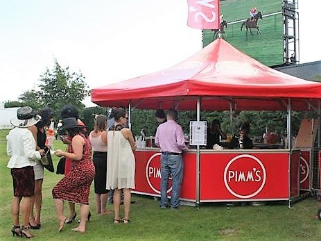 <p>Event, Mobile & Stadia Bars – Tents & Marquees – Octagonal Pavilion</p> <p> </p> <p>Pimm's Outdoor Event Bar</p> <p> </p> <p>These type of bars are loved by many racecourses and their customers.  Fully branded printed base panels and printed roof.</p> <p> </p> <p>A roof flag is also branded in matching colours and logo making the outdoor bar stand out in the crowd</p>