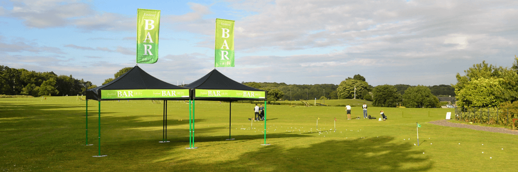 Bespoke Festival Bar branded Classic Folding Tent Bar with green coloured frame and roof flags