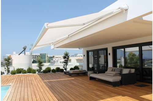 Markilux Awnings Solar Protection MX-3 Curves Hotel poolside terrace