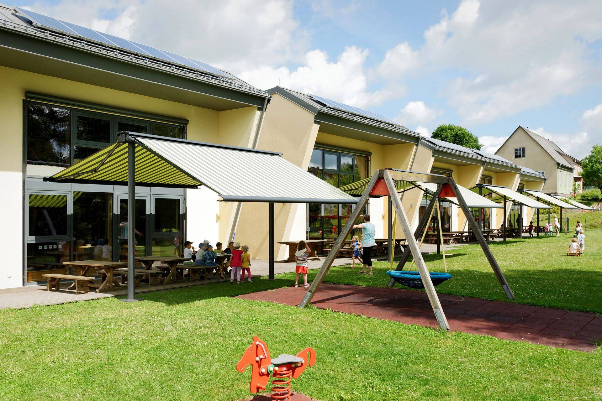 <p>Markilux Awnings Solar Protection Syncra Coupled Unit School Playground</p> <p></p> <p>Using the Syncra Pergola duo unit, school playground areas and outside classrooms can be extended and protected</p>