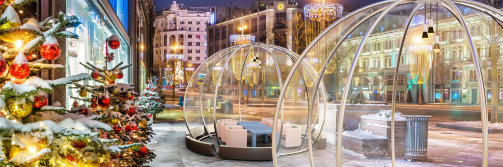 Dining Igloo All-Weather Dining Pod on an outdoor street setting with table and chairs set