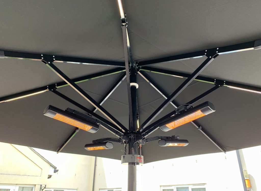 Heating and Lighting displayed on a Stylish Parasol ideal for hospitality industry to extend their outdoor terrace