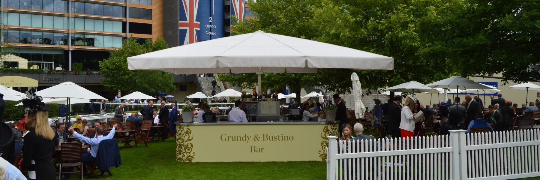 <p>Parasols-Jumbo-Umbrella-Bar-Premium-Stylish-Champagne-Racecourse-Bar</p> <p></p> <p>Elegant Jumbo Parasol offering the ideal shade solution, providing super reinforcement in the framework and arms, giving comfort and protection from the environmental conditions be it blazing hot sunshine or rain.</p> <p></p> <p>Popular not just within the hospitality industry and associated sectors, but also the parasol of choice of commercial and residential customers who demand high quality and cover for a larger space</p> <p></p> <p>Situated here within a premium quality champagne bar at a Racecourse</p>