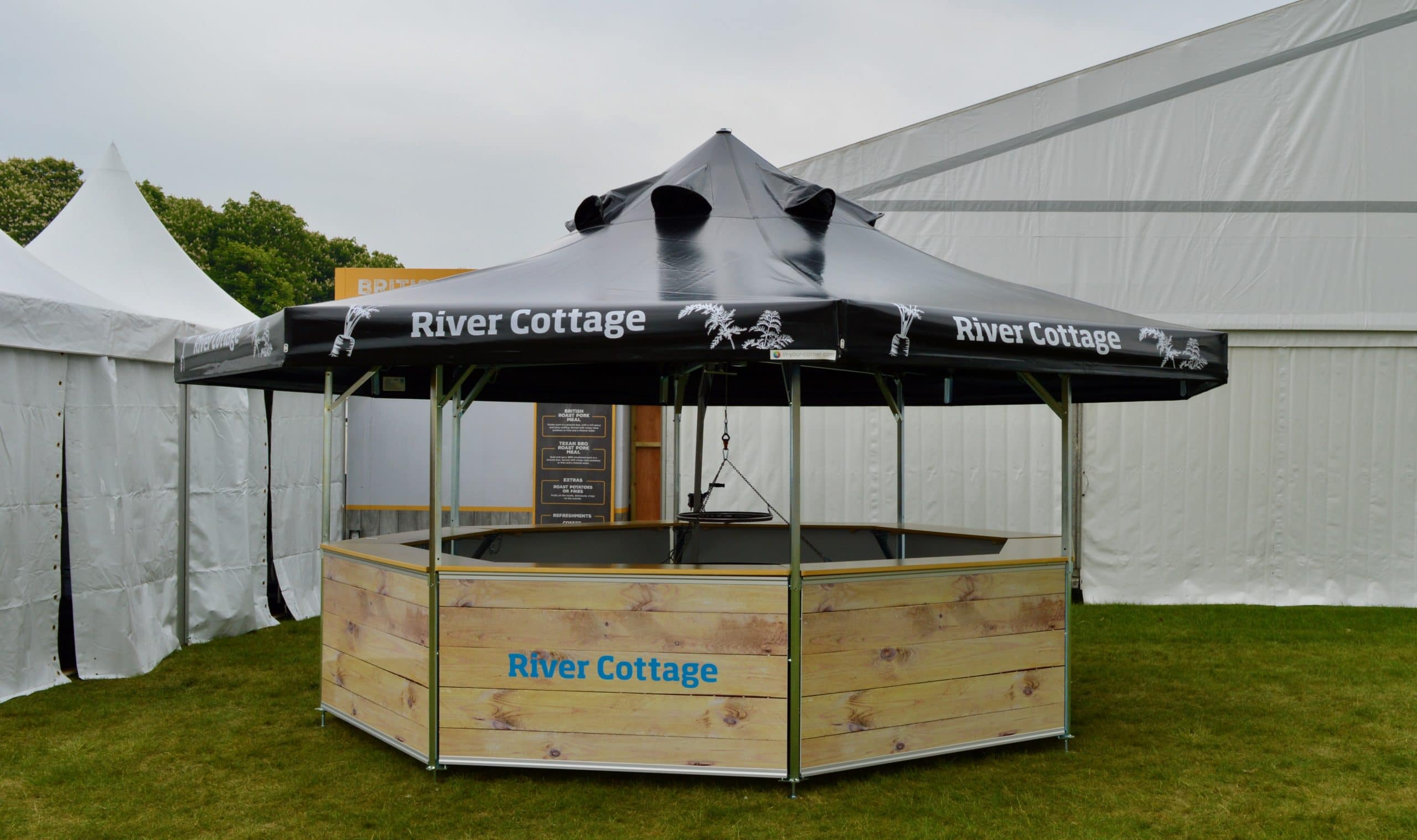 <p>Barbecues & Grills – Sanki Swinging Grills – Commercial Grill – Octagonal Pavilion – Windsor Horse Show Catering – River Cottage</p> <p>Sanki Swinging Grill housed in an Octagonal Pavilion supplied with special roof openings. Branded to customer design and needs</p> <p>Showing Grill with warming Ring.</p> <p>Suitable for Pubs, Restaurants, Events such as Music Festivals, Horse Shows, County Shows etc</p>