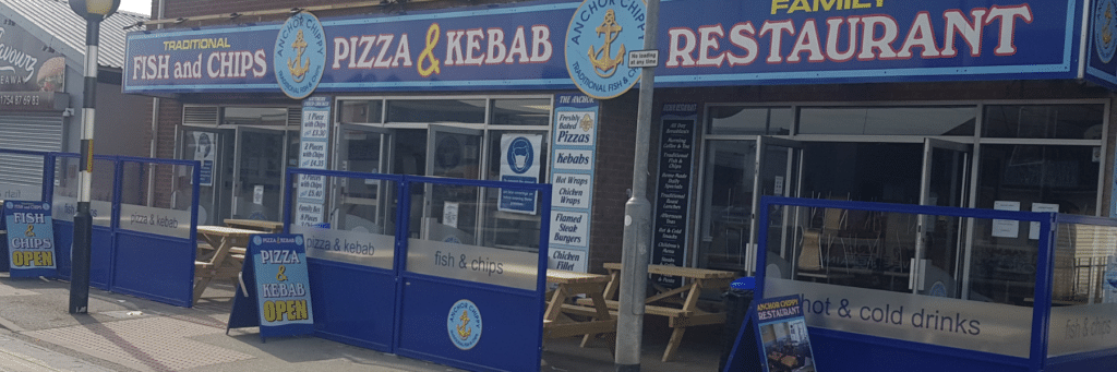 Outdoor Chippy Restaurant Terrace defined using Gibli Terrace Screens branded company logo and to blend with the overall kerb appeal