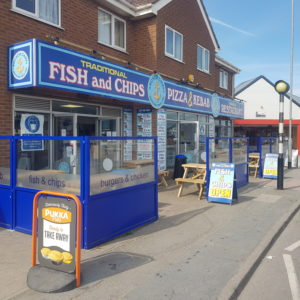Outdoor Chippy Restaurant Terrace defined using Gibli Terrace Screens branded company logo and to blend with the overall street appeal